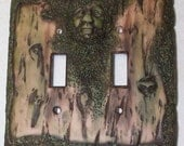 Green Man double toggle light switch cover: wood look with moss