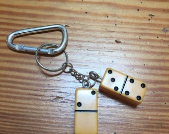 Keychain with vintage butterscotch bakelite dominos .