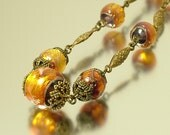 Vintage/ antique/ estate Art Deco 1930s brass and orange, foiled glass bead costume necklace - jewelry / jewellery