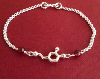 dopamine molecule bracelet with garnet in sterling silver