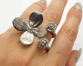 Delicate Sterling silver flower with Rose cut diamonds surrounded by diamonds by Zulasurfing