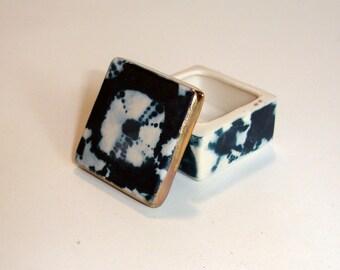 tiny indigo porcelain box with underglaze decoration and 22k gold luster