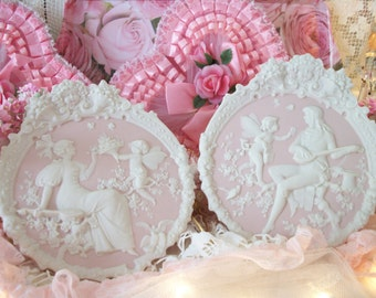 love is in the air. matched pair, pale pink & white vintage bisque romance scene plaques, cupids, bas relief, romantic french cottage charm