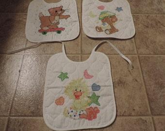3 White Cross Stitched Bibs: Ducky, Bear, Cat