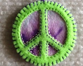 Peace sign ornament in purple tie dye and lime green felt