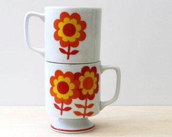 Vintage 1970s floral pedestal stacking mugs.