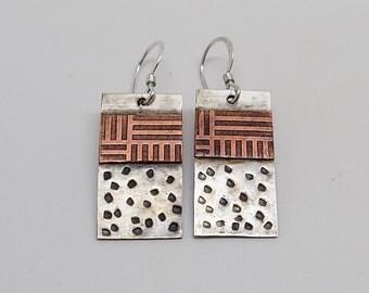 Mixed metal steampunk jewelry earring.