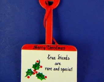 0030 Holly shovel ornament. Free shipping.   Message shown is a suggestion. Ornaments can be written with a message/name/date of your choice
