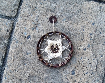 Small Wall Hanging Crochet Flower on Rusted Metal