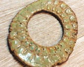 200. A Hole in One Textured Stoneware  Disk Pendant/Cabochon Mushroom