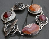 RESERVED for Vicki oOo dryhead agate, ruby, fire agate, garnet and sterling silver metalwork link bracelet