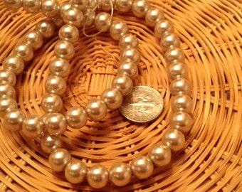 2 strands glass beige pearls