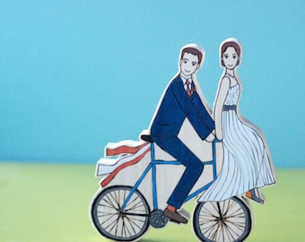 Custom Wedding Cake Topper Couple on Bike with One on the Handlebars and Ribbons