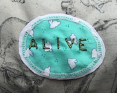 Handmade ALIVE word Patch - hand embroidered onto a sea green/blue (with bunnies) fabric - Cute Denim Flare, Pro Life/Pro Choice, OOAK gifts