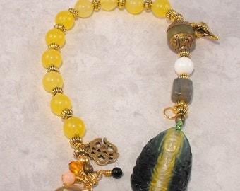 Green and yellow glass Kuan Yin  meditation beads