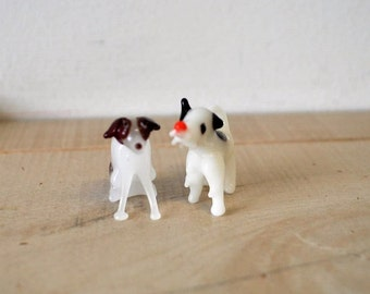 two adorable vintage glass blown black and white puppies / dogs