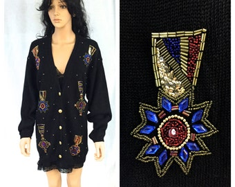 Vintage Black Cardigan Sweater. Size Large. Claudia Barnes. Sequin Medals. Awards. Medals of Honor. Red. Purple. Blue. Under 50. Holiday.