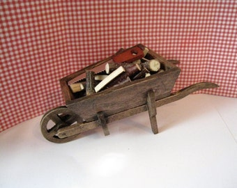 Dollhouse Country wheelbarrow , wheelbarrow, garden barrow, wood logs, twelfth scale, dollhouse miniature