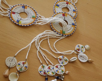 beaded wall hanging or necklace with charms