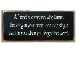 A friend is someone who knows the song in your heart... primitive wood sign