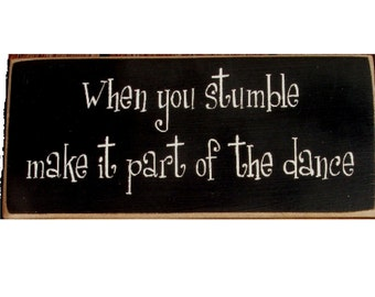 When you stumble make it part of the dance wood sign