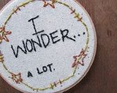 the I WONDER a lot hoop .... one of a kind, hand stitched embroidery hoop