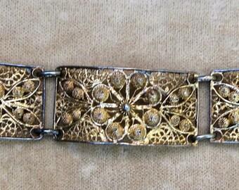 A Five Panel Bracelet in Gold Filagree