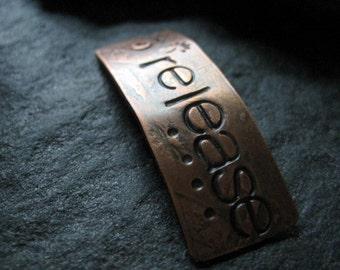 release  -  pendant in warm copper