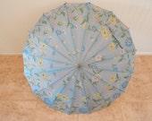 Vintage Light Blue Umbrella With Floral Design and Bake Light Handle
