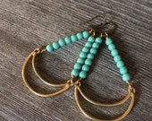 Hanging moon earrings in Turquoise