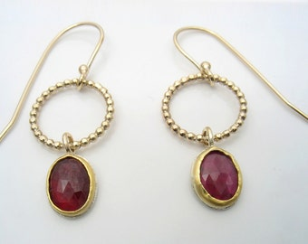 Solid 22k yellow gold  shaping a deep red rose cut oval Ruby, dangling, feminine, statement earrings.Matching a delicate Ruby necklace.