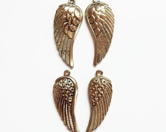 Gold wing charms - pendants
