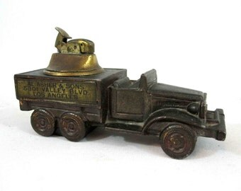 "Vintage Truck Table Lighter with Advertising, Marked ""Dodge Inc."" in Brass Finish. Circa 1930's."