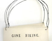 gone hiking   ...   3  hanging porcelain signs