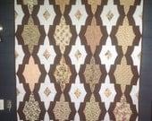 Brown medallion lap quilt...