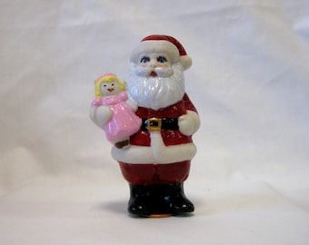 "Porcelain handcrafted 3.5"" Santa penny doll  holding a doll"