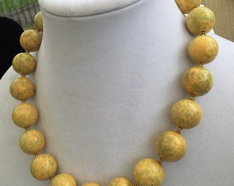 Yellow beaded necklace with gold leaf clasp