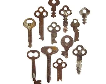 12 vintage keys Primitive and rustic keys Vintage flat keys Artist supply keys Small keys Odd flat skeleton keys Flat skelton key Rusty #31