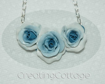 "Necklace of 3-porcelain like handmade Cottage Style Roses with a Blue Fade  16"" Silver Chain"