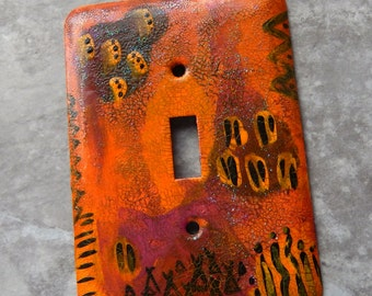 Tribal Sunset, switch plate cover, mixed media abstract with a primitive tribal motif,