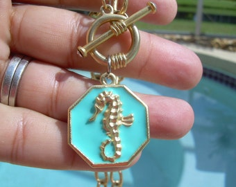 Vintage Hammered Gold tone chain with Toggle clasp with rhinestones, featuring Whimsical Sea Horse on Octagonal Teal Enamel Charm
