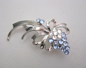 Delicate blue crystal flower brooch pin silver tone setting