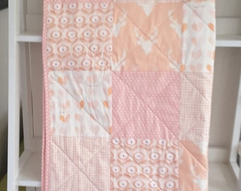 pink/peach patchwork cot quilt