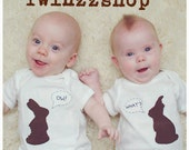 "Chocolate Bunny TWIN Bodysuits Set, featuring ""OW"" and ""WHAT"" Bitten Chocolate Bunnies onesies"