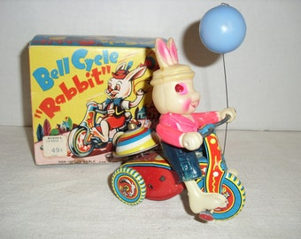 SALE....Bell Cycle Rabbit.  Celluloid Bunny.  Made in Japan Toy.  Wind-up Toy.
