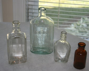 Four Vintage Glass Bottles Three Clear Porters Syrup Hydrophophites Fellows One Amber Lysol