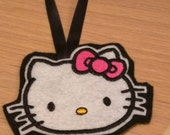 Black and pink kitty tree ornaments embroidered onto sparkly felt and matching ribbon