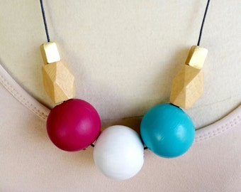 Wooden bead necklace. Features extra large 28mm beads. wood and metal. fuscia and teal. natural wood.