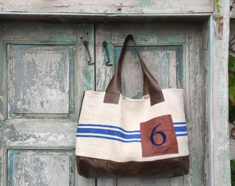 Handmade Bag created from Brown Leather and vintage French Grain Sacks highlighted with Navy Blue Custom Embroidery,