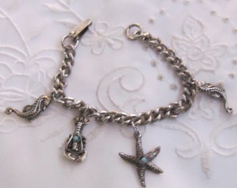 Vintage Silver Tone Charm Bracelet with Starfish, Seahorses, and a Lobster with Faux Turquoise Beads